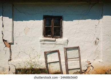Exterior of an old ruined house, wall and window details during day.