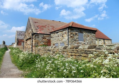 Exterior of old stone cottage in countryside, North Yorkshire, England.