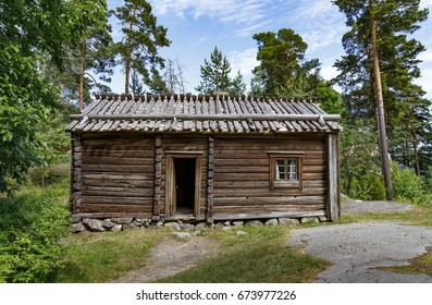 Exterior of an old wood made farm house or log cabin in forest