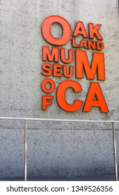 An exterior orange sign at the Oakland Museum in Oakland, Ca on May 23, 2014
