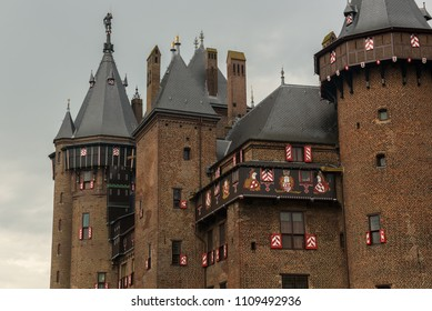 Exterior of parts of De Haar Castle with towers and windows in neo gothic style as designed by architect Pierre Cuypers.