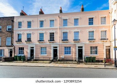 Exterior of Pastel Coloured Terraced  Houses on a Sunny Autumn Day. Greenwich, London, UK.