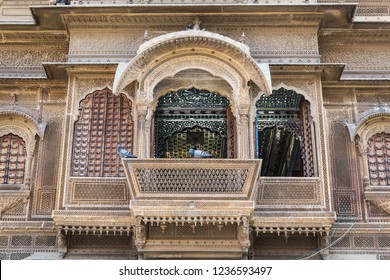 The exterior of Patwon Ki Haveli, Jaisalmer, Rajasthan, India. With balconies and perforated stone or lattice screens known as Jali