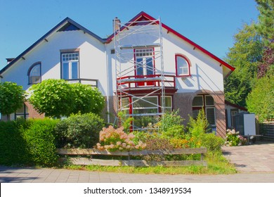 Exterior renovation and painting of old Dutch houses, Netherlands