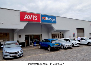 Exterior of Rental car & vehicle hire company in Edinburgh. Avis & Budget car hire with tourists in forecourt collecting car. Edinburgh Scotland UK. jULY 2019