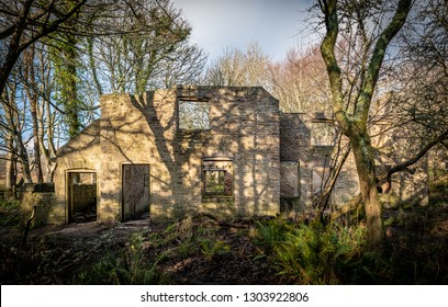 The exterior of ruined buildings in the deserted village of Tyneham in Dorset. Left empty since WWII.