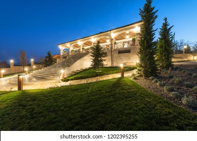 Exterior of rustic house, villa by night