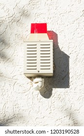 exterior siren on a house wall