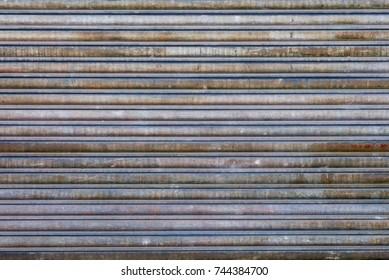 Exterior Surface of Rusty Metal Slats