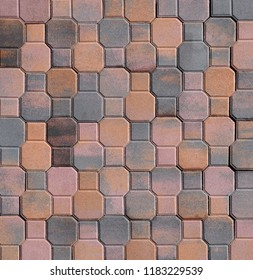 Exterior tile pavement made in the shape of octagons and squares .Colors are pink, brown, orange and gray.