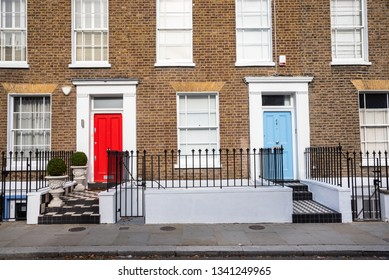 Exterior of Traditional British Brick Terraced Houses with Beautiful Colourful Wooden Front Doors