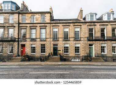 Exterior of Traditional Terraced houses with Colourful Wooden Doors in Edinburgh City on a Cloudy Autumn Day