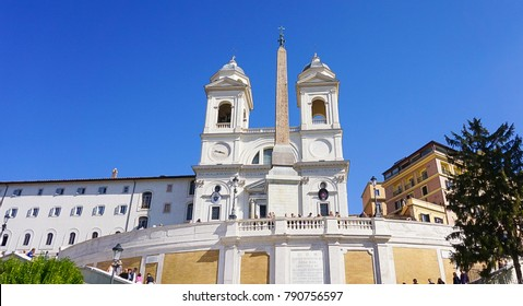 The exterior of the Trinita dei Monti in Rome, Italy above the Spanish Steps which lead down to Piazza di Spagna.