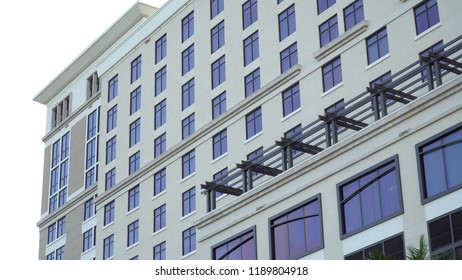 Exterior typical establishing shot stock photo of generic building facade during day time as apartment condo or hotel structure.