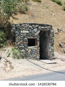 Exterior view of an abandoned slipform stone mining outpost in the foothills of California