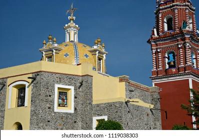 Exterior view of the Baroque architecture church Santa María Tonantzintla in Cholula, Puebla Mexico.