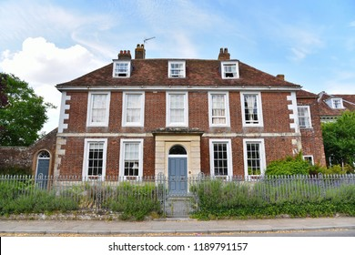 Exterior View of a Beautiful English Georgian Era Red Brick Town House and Surrounding Street