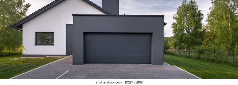 Exterior view of a beautiful house with garage, panorama