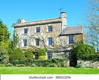 Exterior View of a Beautiful Old English House on a Lush Village Green