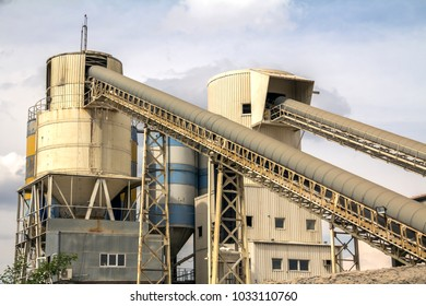 Exterior view of a cement factory. Concrete mixing silo
