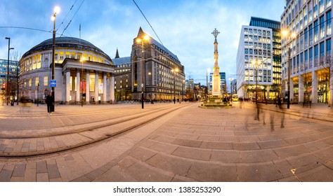 Exterior view of the curved building of the central library of Manchester and war memorial at St Peters Square, Manchester, England.