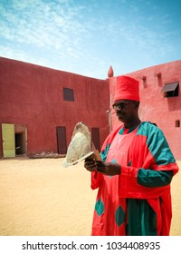 Exterior view to Damagaram sultan residence and portrait of sultans guard in national uniform 24 september 2017 Zinder, Niger