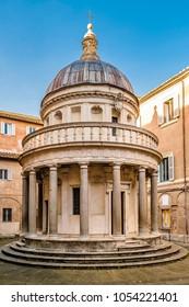 Exterior view of famous reinassance bramante masterpiece tempietto located at San Pietro in Montorio courtyard, Rome, Italy