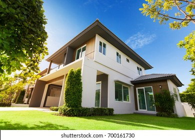 Exterior view of house with green grass.Home For Sale,Rent,Housing and Real Estate concept.