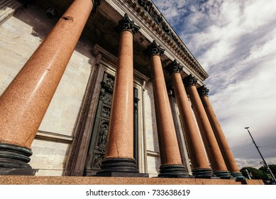 Exterior view of huge columns decorating entrance to beautiful Saint Isaac Cathedral in city of Saint Petersburg.
