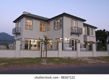 Exterior view of a modern house at dusk