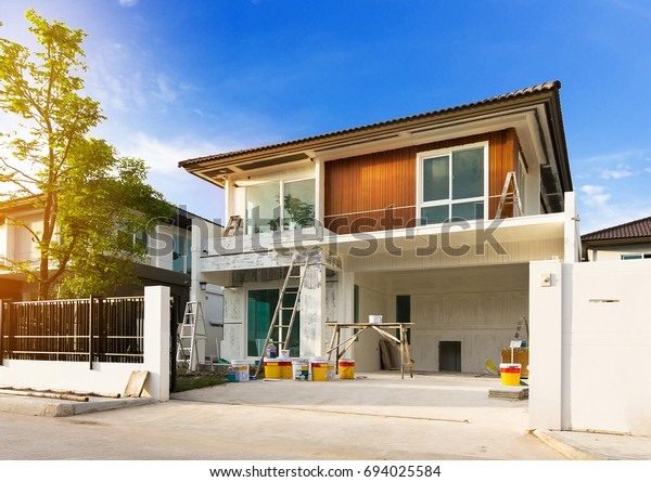 Exterior view of new house under construction and painting.House Painting in morning