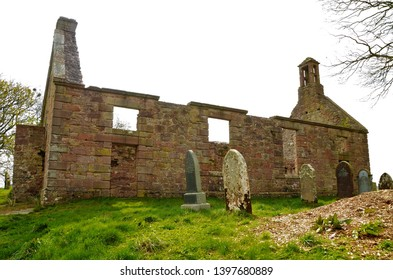 An exterior view of an old ruined rural church building in Dalton in the Scottish borders