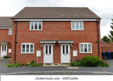 Exterior View of Red Brick Semi Detached Town Houses on a Typical English Residential Estate