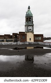 An exterior view with reflection of the clock tower and factory of the abandoned Scranton Lace factory in Scranton, Pennsylvania.