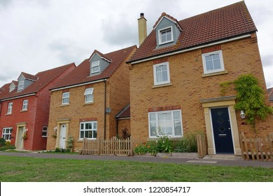 Exterior View of a Row of Beautiful Redbrick Town Houses on a Typical English Residential Estate