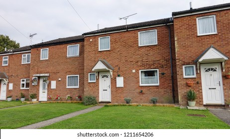 Exterior View of Terraced Red Brick Houses on Typical English Residential Estate