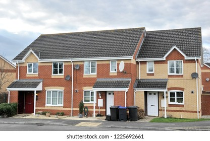 Exterior View of Terraced Red Brick Houses on a Street of a Typical English Residential Estate