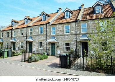 Exterior View of Terraced Stone Cottages on a Street in a Typical English Town