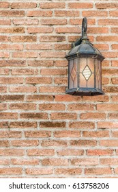Exterior vintage lamp decorated on brick wall building.