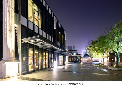 exterior of a vintage shopping mall at night