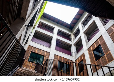 Exterior wall of a building, contemporary style. Transparent sunroof. Worm's eye view.
