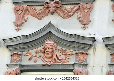 Exterior wall details from Preysing Palais in Munich, Germany, built 723 to 1728 by Joseph Effner in Late Baroque style, but with the recognisable faces of the Bavarian peasantry as decoration