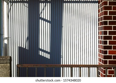 exterior wall of office building and shadow