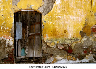 Exterior wall of an old house in the colonial city of Antigua Guatemala, Guatemala, Central America.