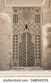 exterior wall with ornament style window. Antique islamic mosque architecture. Cairo egypt. Historic heritage buildings. Oriental design. Hand craft decoration. Arabic detailed ornaments.