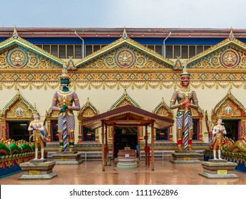 Exterior in Wat Chayamangkalaram Temple - Statues standing outside, Georgetown, Penang, Malaysia.
