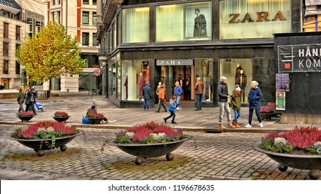 Exterior of Zara luxury store in Oslo. The fashion brand has made the history of elegance for men and women. People walk along the street. Shopping in Norway. Oslo – November 4, 2017