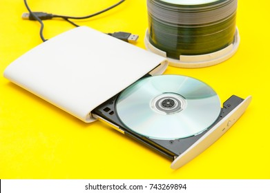 external dvd writer and cd,dvd On a yellow background.