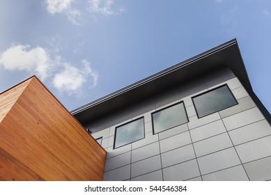 External facade of a modern house under a blue sky