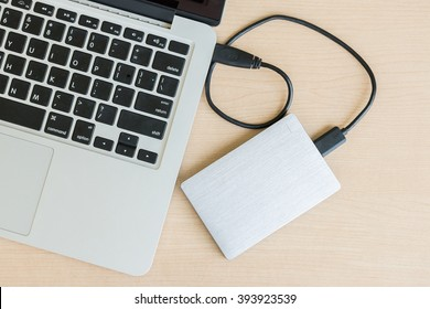 External hard drive connected to laptop computer